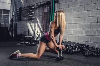 Athletic girl in a gym club
