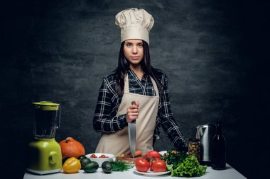 Female chef holding a knife