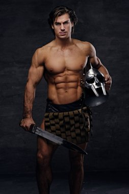 Muscular male in a Rome soldier costume