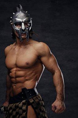 Athletic man in silver gladiator helmet