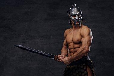 Muscular man holds an iron sword