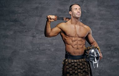 Man holding silver gladiator helmet