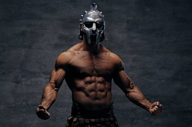 Muscular man in a gladiator silver helmet