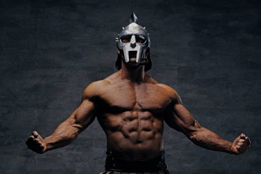 Muscular man in a gladiator silver helmet