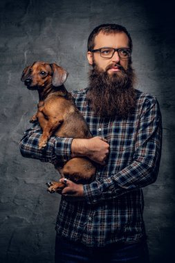 Bearded hipster man holding dog