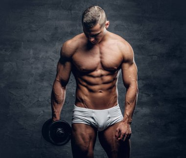 Man in a white panties holding dumbbell