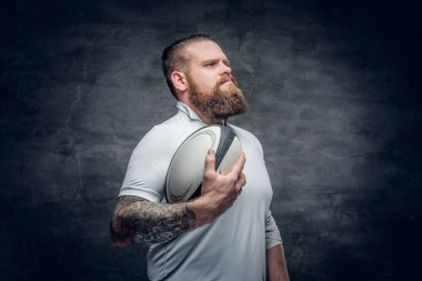 Bearded rugby player with tattoos