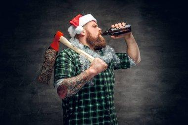 Brutal bearded man in Santa's hat