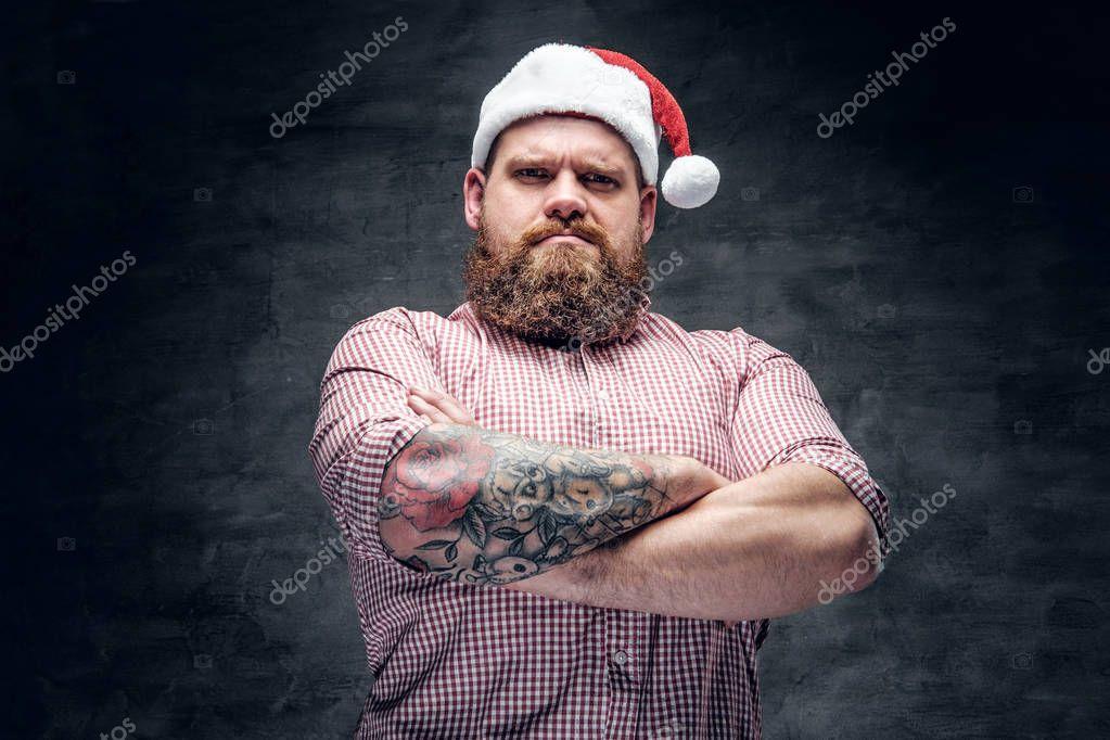 Bearded man wearing Santa's hat