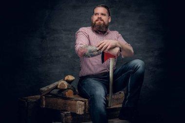 Bearded lumberjack holding an axe