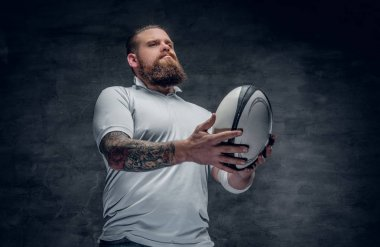 Rugby player catching a game ball