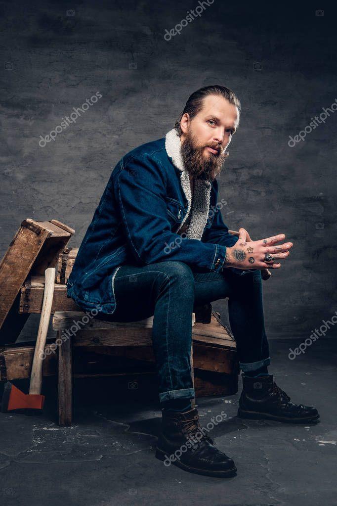 Bearded man wearing a denim jacket