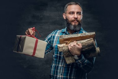 Man holding woods and gift box