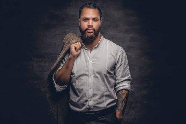 Bearded black man with tattooed arm