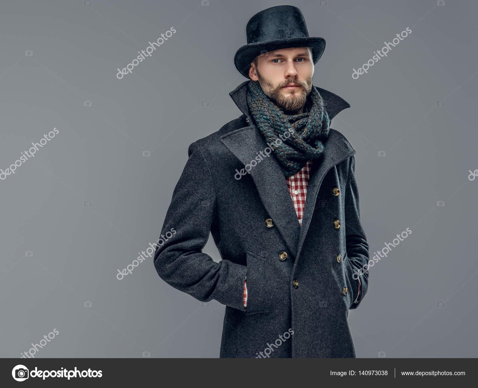 Uomo in una giacca grigia e un cappello a cilindro — Foto Stock ... 0fa98a9349dc