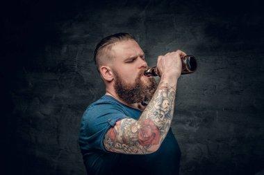 Bearded man drinks beer