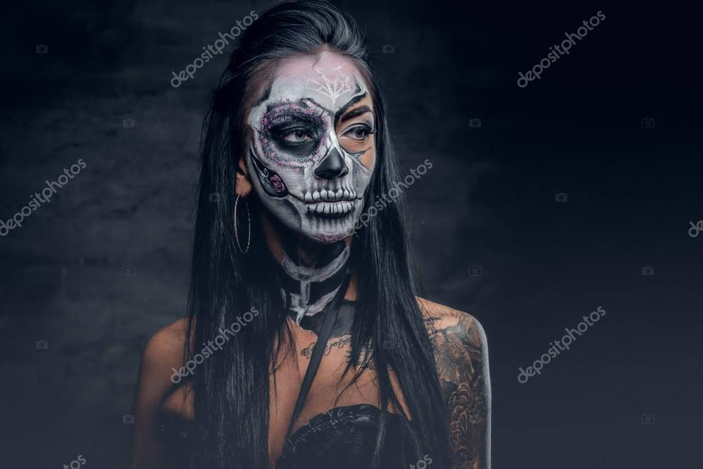 Zombie woman with painted skull face