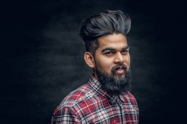 A handsome bearded Indian male