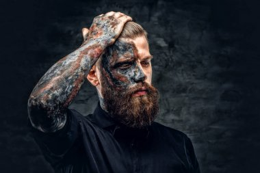 A man with burning make up