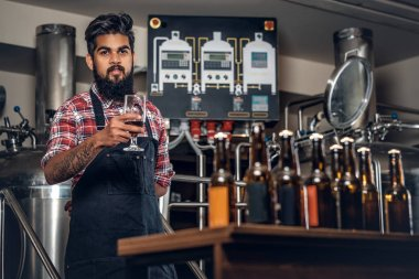 Indian man presenting craft beer