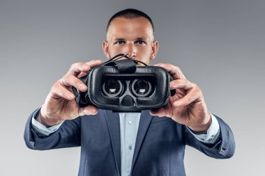 Man showing virtual reality glasses
