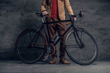 Man posing with single speed bicycle