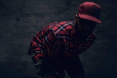 man in red fleece shirt and cap