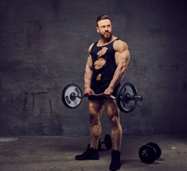 Man doing biceps workout with barbells