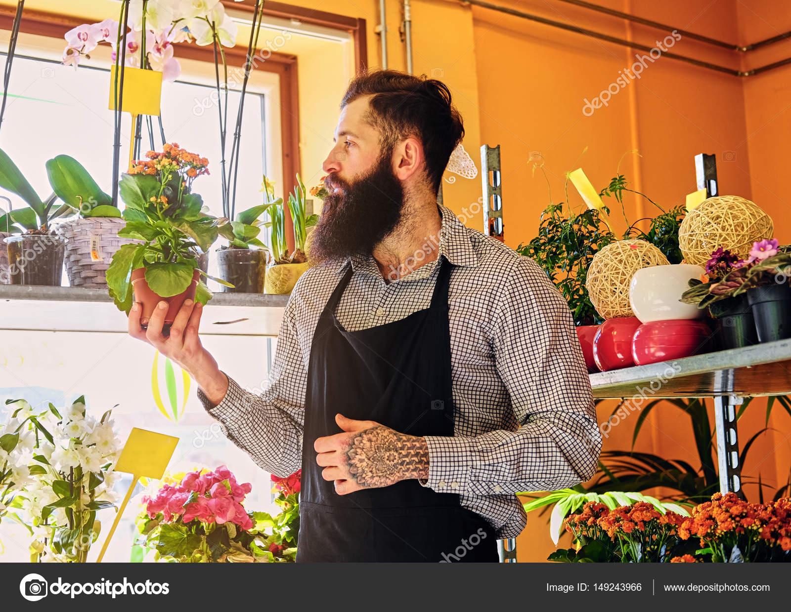 depositphotos_149243966-stock-photo-brutal-bearded-flower-seller.jpg