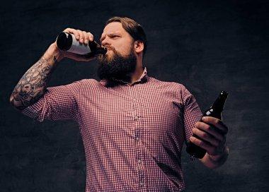 Bearded man drinks a beer