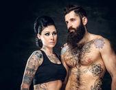 Studiový portrét Tetovaný páru