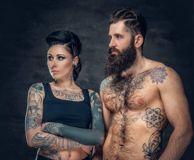 Tattooed bearded man and brunette woman
