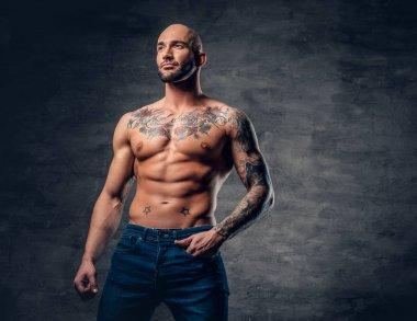 Shirtless man with tattooed torso