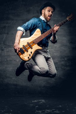 Funny bass player in a jump