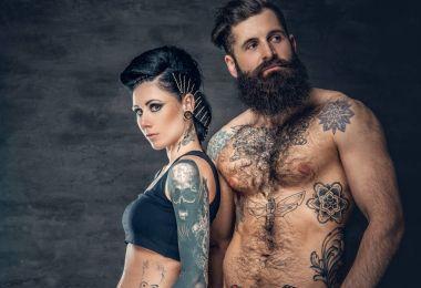 Studio portrait of tattooed couple