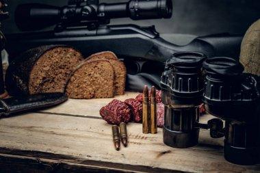 Retro hunting ammunition of rifle and binoculars.