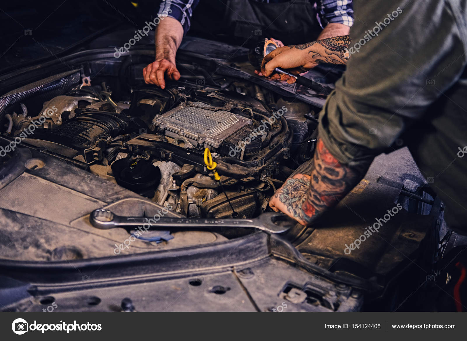 Two mechanics fixing car\'s engine — Stock Photo © fxquadro #154124408