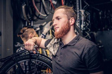 Bicycle mechanics in a workshop