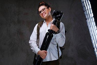 Female holds digital photo camera