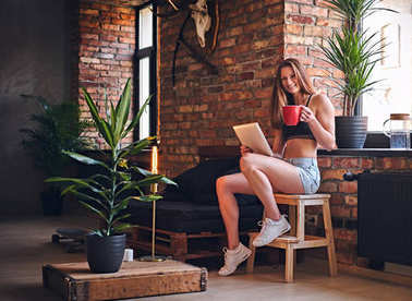 Attractive sporty female using tablet