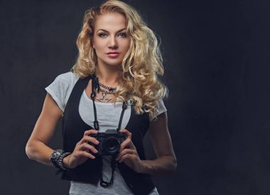 Blonde female photographer taking pictures