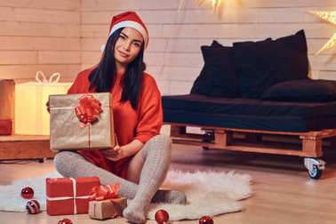 brunette  in  red clothes  with Christmas gifts