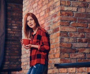 Redhead female in fleece shirt.