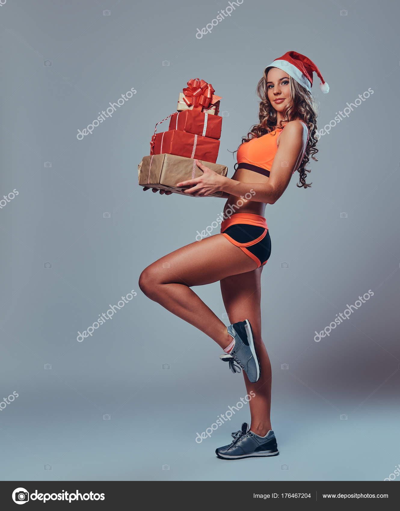 Die Volle Körperbild Blond Sportlich Frau Weihnachtsmütze Hält ...