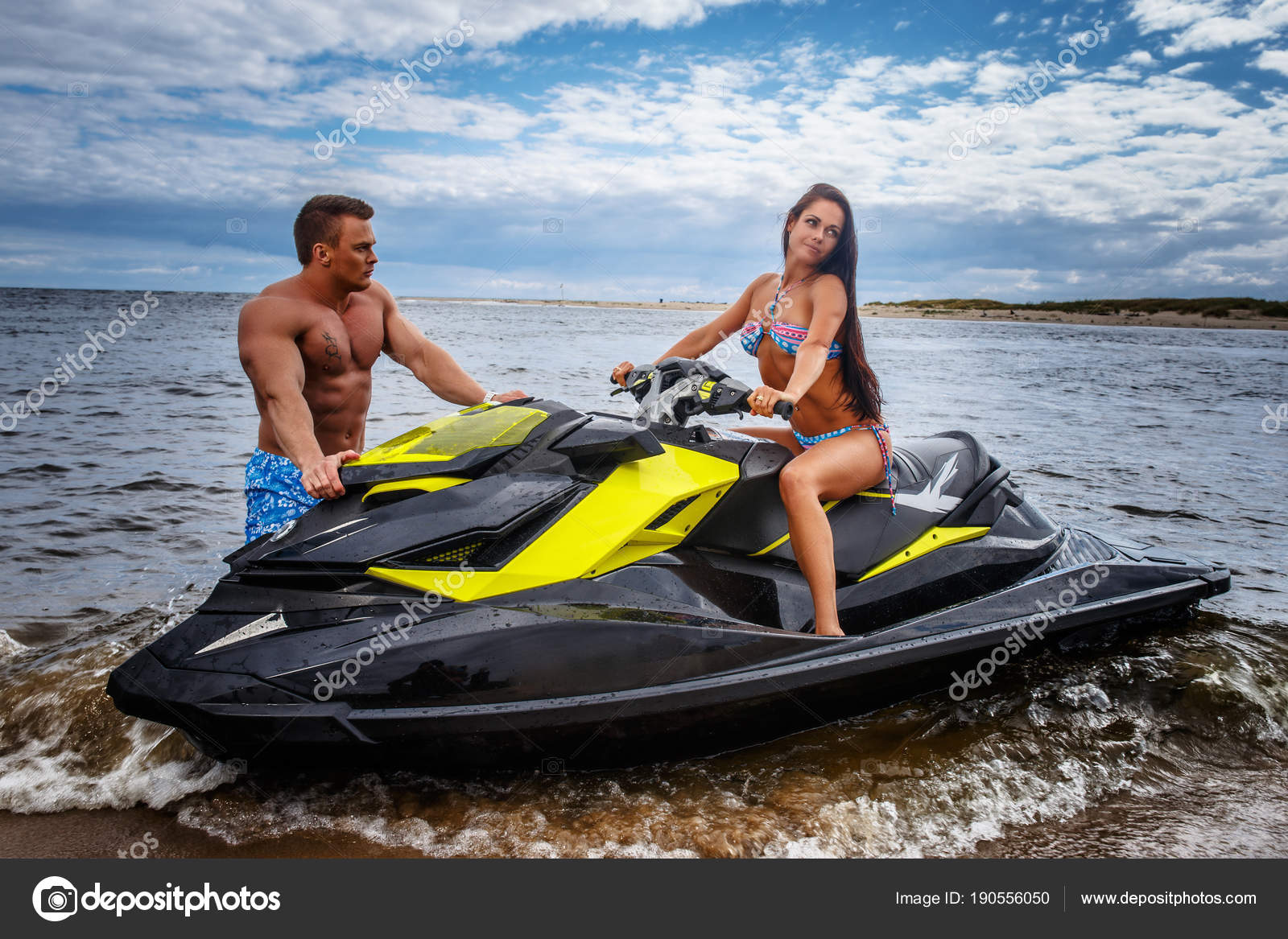 Attractive Couple Of A Sexy Girl And Shirtless Muscular Male Have Fun With A Jet Ski On A Seacoast Stock Photo C Fxquadro 190556050