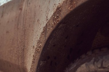Close-up image of a dirty car after a trip off-road. Front fender.