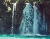 Beautiful waterfall in the forest tropical zone. Waterfall landscape.