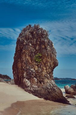 Beautiful landscape rocky stalactite reefs on the shore of Philippine Islands.