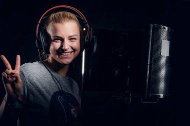 Portrait of singing girl at audio studio