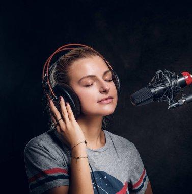 Portrait of nice singer at studio